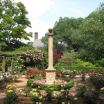 Garden with statuory pillar in center.