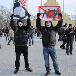 Anti-ACTA demonstrators wearing Guy Fawkes masks.